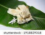 Small photo of A common rice cake from Bangladesh, local name Binni chaler pathishapta pitha, goigga pitha, Puli, biroin chaler petha, binni rice pitha. Made by Forbidden Rice, coconut and sugar. on Banana leaf.
