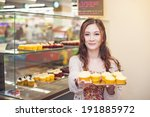 Pretty Asian Woman Working At...