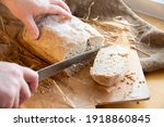 Woman Slices Fresh Bread. Hands ...