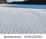 Ice Sheet On A Lake Covered...