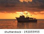 Fishing Trawler At Sunset