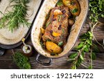 Venison roasted with rosemary and garlic - stock photo