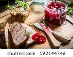 Closeup of venison with cranberry sauce - stock photo