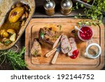 Freshly served venison with cranberries and rosemary - stock photo