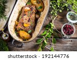Venison roasted with rosemary, garlic and cranberries - stock photo