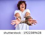 snake tied man's hands. man... | Shutterstock . vector #1922389628