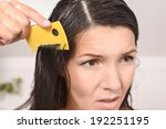 Woman Combing Out Lice In Her...