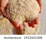 A Man Holding Beautiful Rice In ...