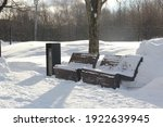 Snow Covered Wooden Benches ...