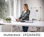 Businesswoman Working At...