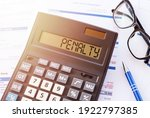 Small photo of Word PENALTY on the display of a calculator on financial documents.