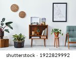 Small photo of Retro composition of living room interior with mock up poster map, wooden shelf, book, armchair, plant, cacti, vinyl recorder, decoration and personal accessories in stylish home decor.