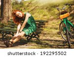 Young Red Hair Woman Is Seating ...