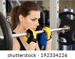 slim young woman exercising in... | Shutterstock . vector #192334226