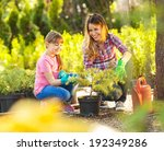 Mother And Daughter Gardening...