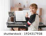 Little Boy Taking Music Lessons ...