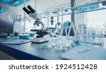 Small photo of Modern Medical Research Laboratory with Microscope and Test Tubes with Biochemicals on the Desk. Scientific Lab Biotechnology Development Center of High-Tech Equipment, Technology.