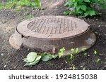 Rusty Sewage Hatch On The Ground