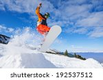 Jumping Snowboarder From Hill...