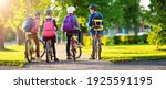 Children With Rucksacks Riding...
