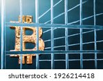 Small photo of Bitcoin in prison. Concept of arrest, fraud and deception with cryptocurrency and mining. Bitcoin ban, imprison or illegal. Big troubles for bitcoin.