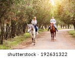 young couple riding a brown... | Shutterstock . vector #192631322