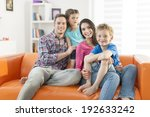 family sitting on a sofa in her ... | Shutterstock . vector #192633242