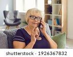 Happy Mature Woman In Glasses...
