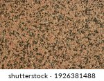 Small photo of Uneven brown granite surface with brack dots