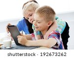 cute brothers with tablet... | Shutterstock . vector #192673262