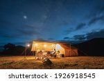 Small photo of Tourists in yellow tent camping on hill with milky way in the night sky at national park