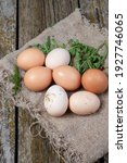 Small photo of quean eggs on old boards and fabrics