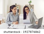 Small photo of Happy single young business woman consulting bank manager, financial advisor or loan broker. Smiling estate agent meeting client at office, talking, showing and offering house design options on laptop