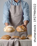baker in a denim shirt holds...   Shutterstock . vector #1927984322