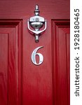 Silver Number 6 On A Red Wooden ...