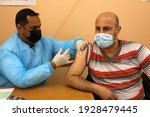Small photo of An employee of the United Nations Relief and Works Agency for Palestine Refugees (UNRWA) gives a shot of the Sputnik V Covid-19 vaccine for medical staff and the elderly, in Gaza Strip, on Mar 3, 2021