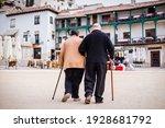 Old Pensioner Couple Walking...