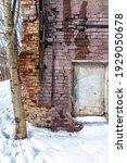 An Old Crumbling Brick Wall Of...
