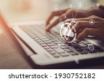 Small photo of Young businesswoman working on his laptop in the office, select the icon cloud on the virtual display.Concept digital technology and cloud technolog