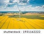 Wind Turbines On Golden Field....