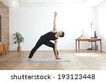 korean man doing yoga | Shutterstock . vector #193123448