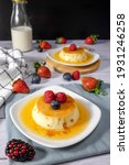 Small photo of Caramel pudding or custard pudding or creme brule with berries