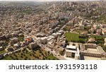 Aerial view over Bethlehem City, Palestinian Authority Drone view over buildings and green fields, at morning