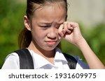 Crying Youthful Girl Student...