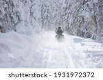 Snowmobile Driving On A Narrow...
