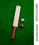 Small photo of cricket bat and ball place on cricket ground green grass