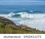 Small photo of Panoramic view of gigantic powerful foamy waves in North Beach of Nazare or Silver Coast, phenomenal underwater canyon, continental shelf, popular surf route in Europe, Portugal. Stormy Atlantic ocean