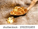 Fish Oil Capsules In A Wooden...