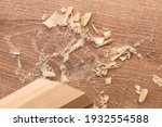 a piece of wood with sawdust... | Shutterstock . vector #1932554588