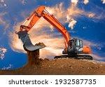 Excavator At Work On...